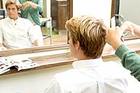 Young Man Having His Hair Cut