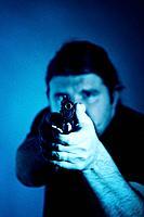 Gunman, adult, adults, aiming, alone, arm, arms, caucasian, crime, criminal, criminals, firearm, firearms, firing, gra