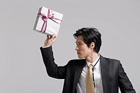 Businessman holding gift, close_up