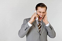 Businessman in pain holding mobile phone, close_up