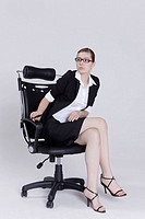 Businesswoman sitting on an office chair and thinking