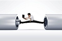 Young businessman stretching his legs on battery with holding laptop