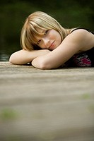 Teenager sitting on a plank
