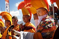 Nuns in traditional dress with yellow orange hats and robes at 800 year old birthday celebration / rituals of the Buddhist Drukpa Lineage, Naro Photan...