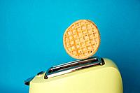 Waffle popping out of toaster