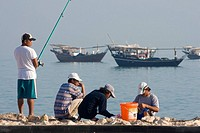 Men fishing at Al Wakrah port, Qatar