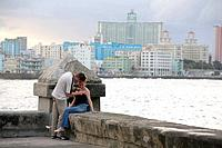 Local pair in the Malecon promenade in Havana, Cuba