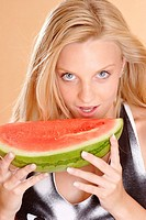 Blonde eats watermelon