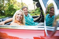 Portrait of a mature man driving a convertible car with a mature woman sitting beside him