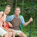 Mature couple looking away at picnic