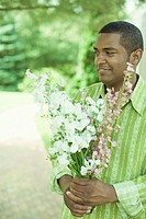 Close_up of a mature man holding a bunch of flowers