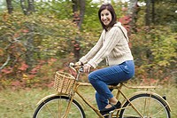 Portrait of a mature woman riding a bicycle and smiling