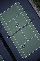 aerial of two tennis players playing tennis
