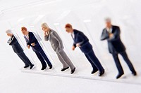 Line Of Businessmen Figurines