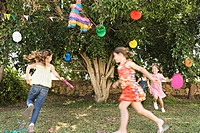 Young girls playing at birthday party
