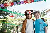Two boys in cow and doctor costumes at birthday party