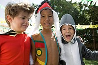Three boys in costumes at party