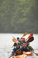 Group kayaking in river