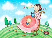 Pregnant woman listening to the alphabet and reading while her baby reads inside her uterus