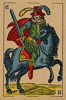 Vintage playing card showing a man with a sword on horseback