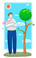 Man standing near a tree