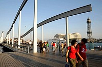 Rambla del Mar footbridge to Maremagnum area and the World Trade Center building at the back ,Barcelona harbour, Catalonia, Spain