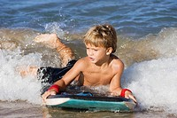 Boy boogie boarding, Maui, Hawaii, USA