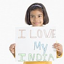 Portrait of a girl holding a placard displaying I Love My India