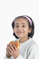 Portrait of a girl eating a hamburger