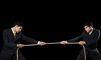 Businessman and his clone playing tug_of_war