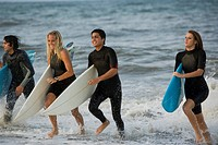People in ocean with surfboards