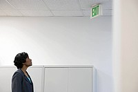 Woman looking at exit sign