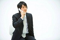 Businessman Using a Mobile Phone, Front View, Copy Space