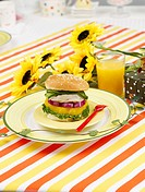 glass cup, plate, sunflower, leaf, tablecloth, orange juice, dish