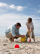 Father and son making sandcastles (thumbnail)