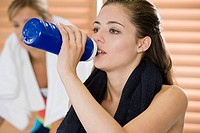 Woman drinking at gym