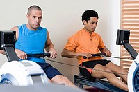 Men on rowing machines