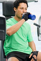 Man drinking at gym