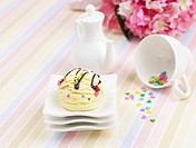 flower, ice cream, creamer pot, cup, small plate, tablecloth, icecream