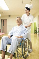 Nurse pushing the wheelchair