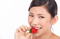 Portrait of Natural Young girl eating Strawberry