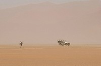 Tourists with a jeep in the desert, Namibia, Africa