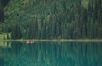 Canoeing on pristine lake, Canadian Rocky Mountains