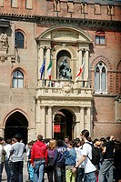 Bologna Italy, students in Piazza Maggiore, in front of Palazzo d´Accursio, former City Hall