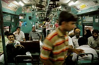 Mumbai India, passengers in a train at Victoria station