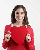 Woman smiling with heart