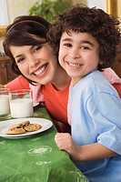 Mother and son with milk and cookies