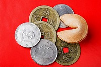 Close_up of Chinese coins with fortune cookie