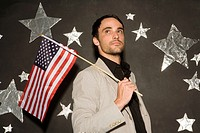 Businessman holding American flag