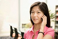 Close_up of a female office worker talking on a mobile phone